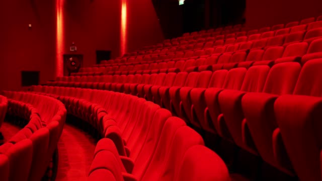 Red seats in theather,horizontal slider move Cinema theater with Red Seats. Red and empty theater seats in a row musical theater stock videos & royalty-free footage