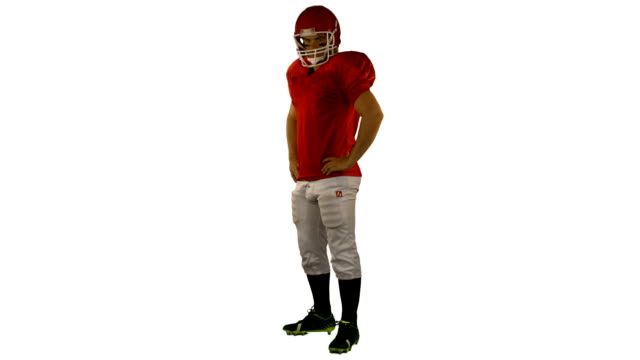 stockvideo's en b-roll-footage met rode ernstige american football speler poseren - handen op de heupen