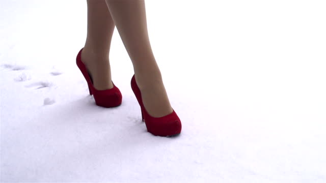 SLOW MOTION: red shoes in the snow video