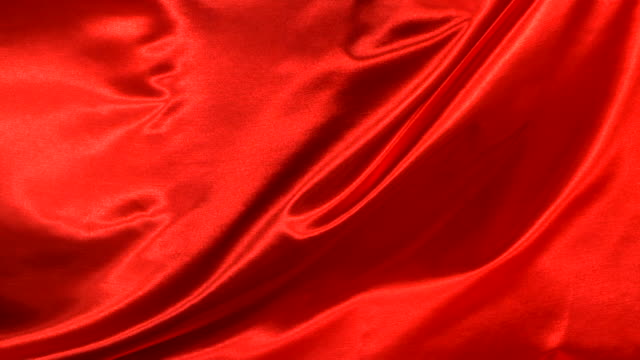 Red silk fabric blowing in the wind