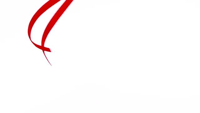 red silk ribbon in water video - nastro per capelli video stock e b–roll