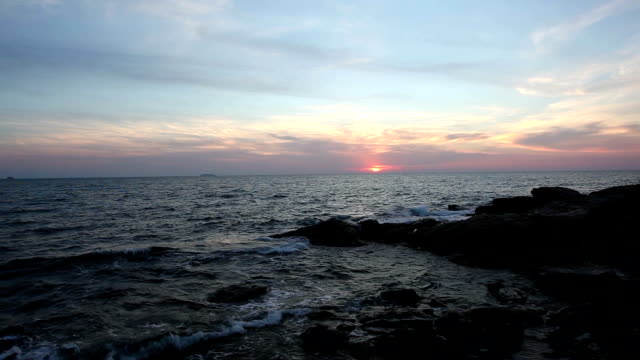 Red sky over the rocky coast video