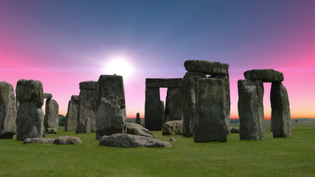 A red sky sunrise over Stonehenge in the UK