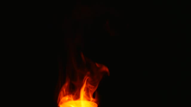 red smoke flame on isolated black background video