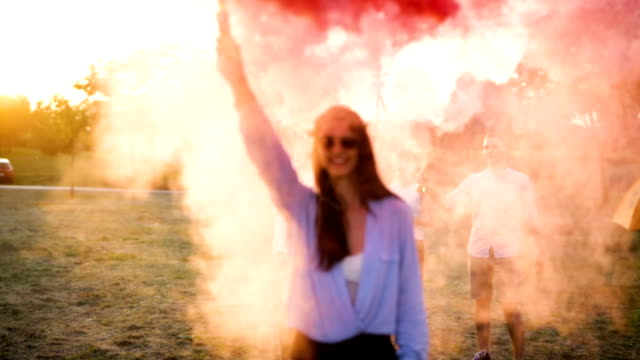 red smoke on the field - hippy video stock e b–roll