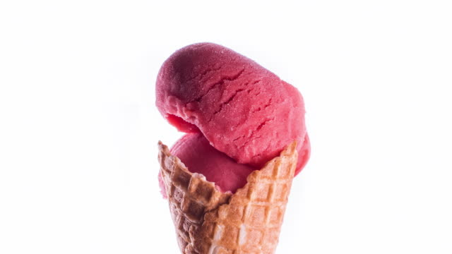 Red Sorbet Ice-Cream Cone Melting Time-lapse of one red sorbet ice cream cone melting back and forth. Loopable shot in 4K resolution on a white background. ice cream stock videos & royalty-free footage