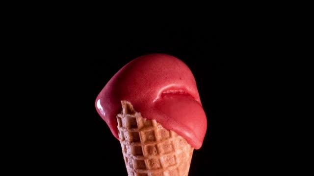 red sorbet ice-cream cone melting - ice cream video stock e b–roll