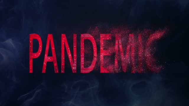 Red, sparkling word 'Pandemic' on dark background. Disappearing disease metaphor