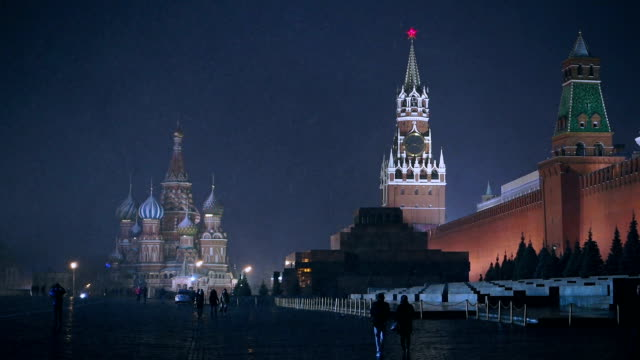 Red Square at night View of Red Square with Moscow Kremlin and St. Basil's Cathedral at night during snow storm. russian culture stock videos & royalty-free footage