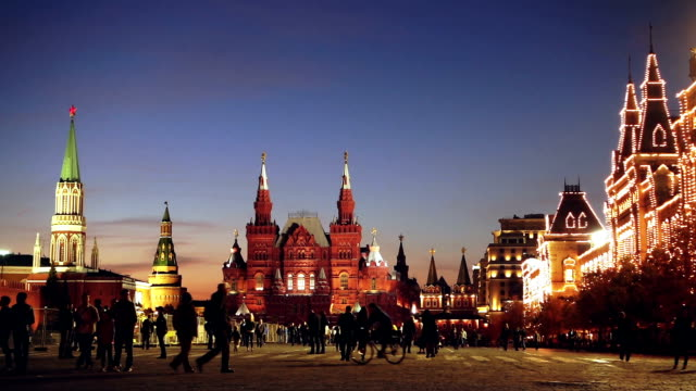 Red Square at summer night View of Red Square with Moscow Kremlin tower, GUM department store and Historical Museum at summer night with tourists walikng by. russian culture stock videos & royalty-free footage
