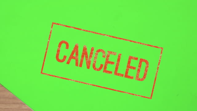 Red stamp canceled on paper chroma key green screen