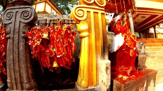 röd staty av hinduisk gud på elefant närliggande många bundna band kamakhya maa templet - india statue bildbanksvideor och videomaterial från bakom kulisserna