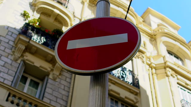 red stop sign standing in the street, safety and caution, driving rules - proibizione video stock e b–roll