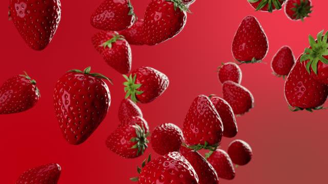 la frutta alla fragola rossa cade dall'alto. animazione 3d. messa a fuoco selettiva. 4k - fragole video stock e b–roll