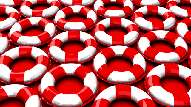 Red swim rings on red background video