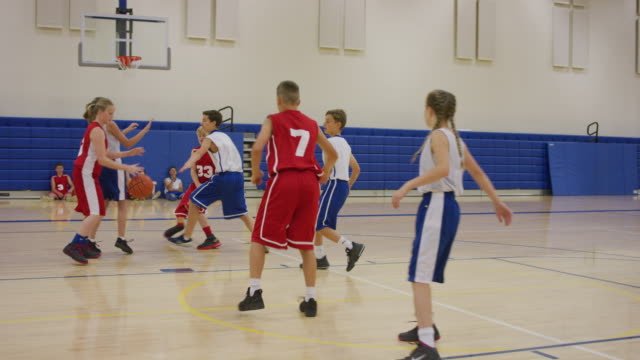 Red team scores basket after many passes Basketball game with coed middle school teams match sport stock videos & royalty-free footage
