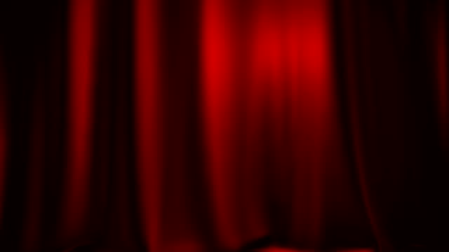 Red theater curtain entering from side with matte video