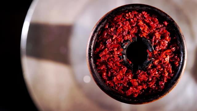 Red tobacco in hookah bowl video