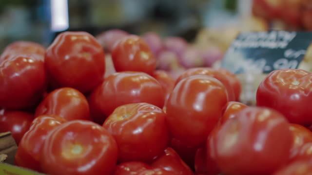 Red tomatoes in supermarket. Background of vegetables. Health food, veganism and vegetarianism concept - video