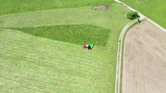 Red Tractor Hay Cutter Aerial View - video