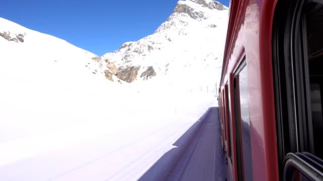 Red train on Bernina Pass in Winter season video