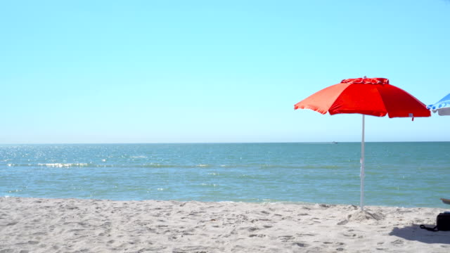 4K Red umbrella on the beach