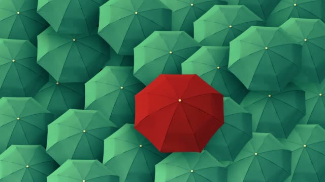 Red umbrella standing out from crowd mass concept video