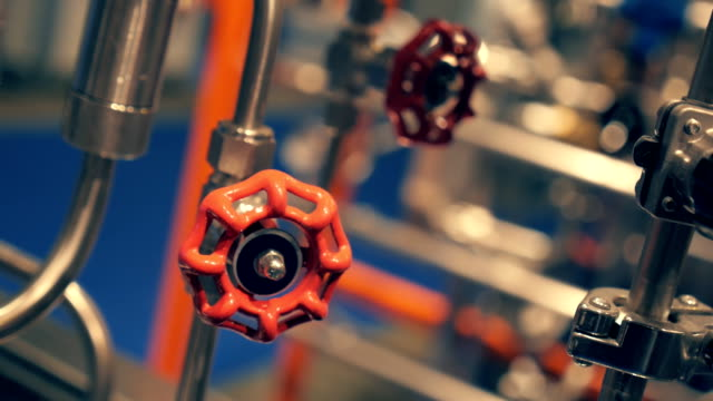 Red valve regulates the flow of liquid reagents in chemical equipment