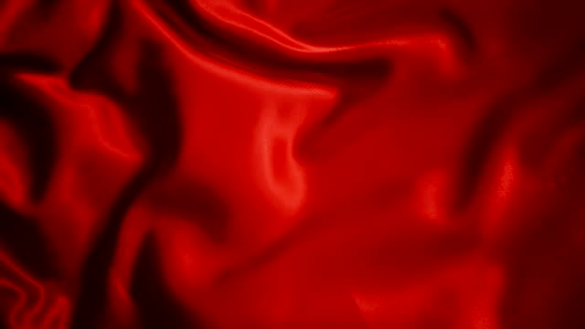 red wave glossy silk fabric  ripple in wind texture background