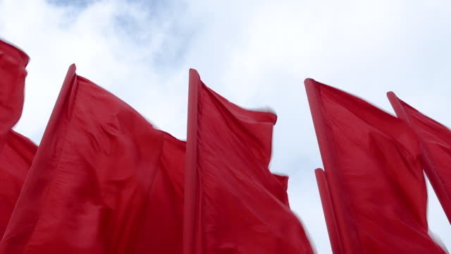 Red Waving Flags Against Sky Red Flags Waving in the Wind Against the Backdrop of Fast-Moving Clouds allegory painting stock videos & royalty-free footage