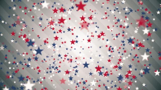 vidéos et rushes de fond rouge, blanc et bleu d'étoiles de confettis des usa - patriotisme