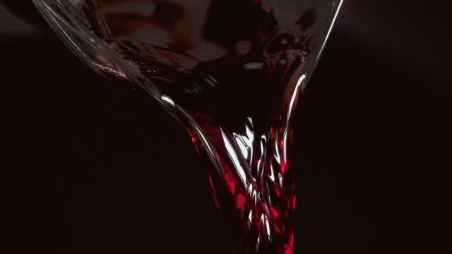 red wine is beautifully poured from the carafe - decanter video stock e b–roll