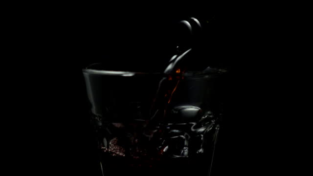 Red wine is poured into a glass slow mo video