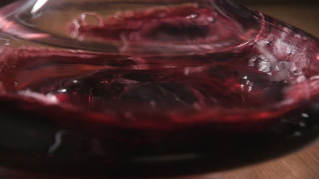 red wine poured into decanter on restaurant background. mixes with oxygen - decanter video stock e b–roll