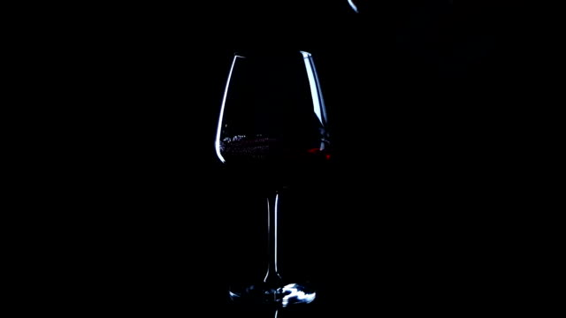 red wine pouring black background video