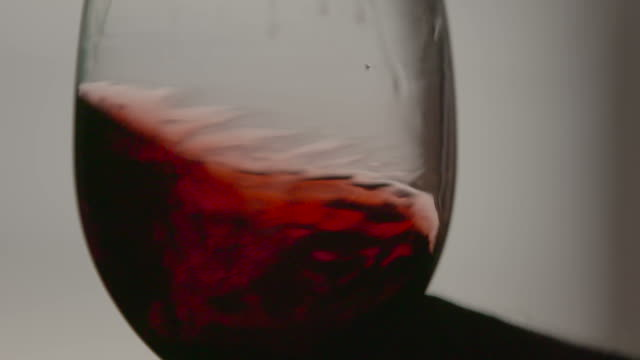 Red wine swirling in slow motion Red wine swirling in slow motion red wine stock videos & royalty-free footage