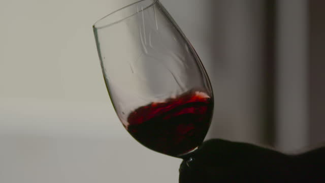 Red wine swirling in slow motion video
