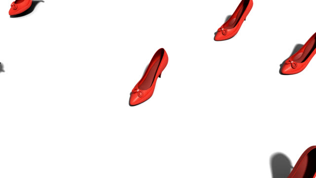 Red women's shoes walking past camera video