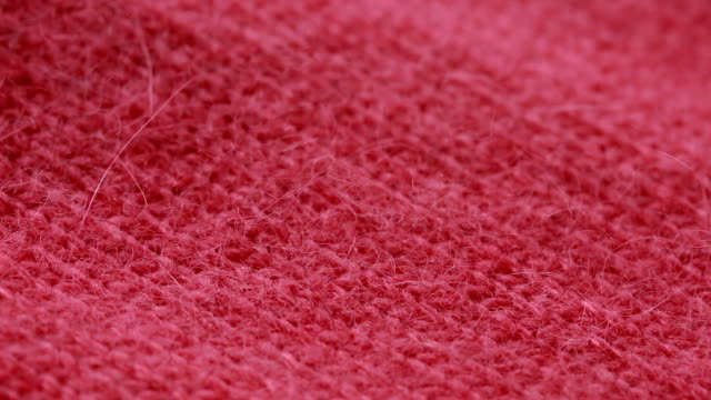 Red woolen worsted sweater pattern. can use as background. video