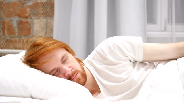 Redhead Beard Man Lying in Bed on side and Sleeping, Relaxing video