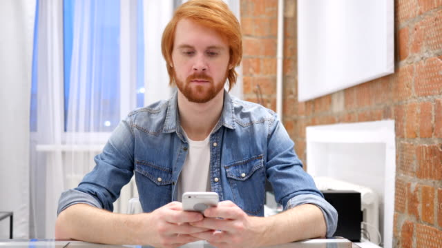 Redhead Beard Man Typing Message on Smartphone, SMS or Email Redhead Beard Man Typing Message on Smartphone, SMS or Email redhead stock videos & royalty-free footage