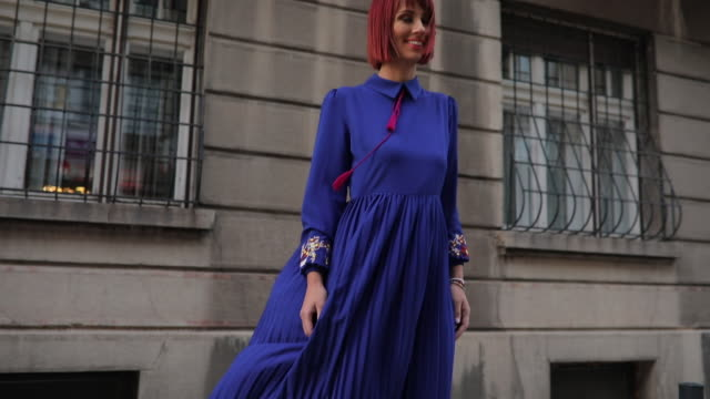 Redhead lady in blue dress One woman, beautiful elegant young redhead lady, standing the city street. dyed red hair stock videos & royalty-free footage