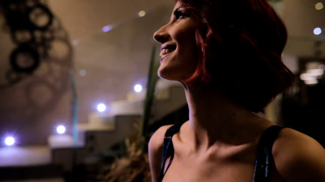 Redhead lady in blue dress One woman, beautiful young redhead lady in elegant blue dress, standing in hotel lobby. dyed red hair stock videos & royalty-free footage