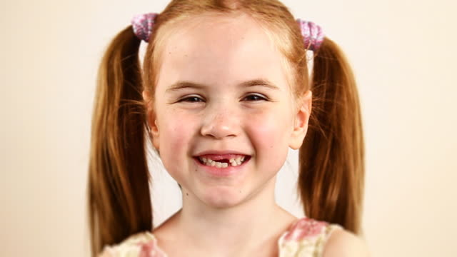 Redhead little girl laughing - HD, NTSC video