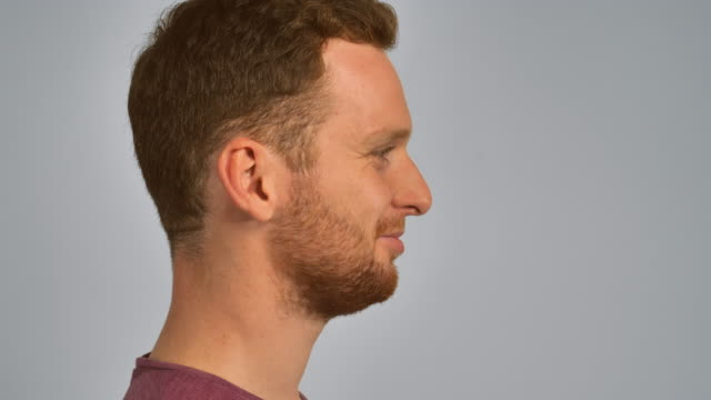 redhead male portrait in profile half-face young man with red hair and beard smiling. happy guy with cheerful smile redhead stock videos & royalty-free footage