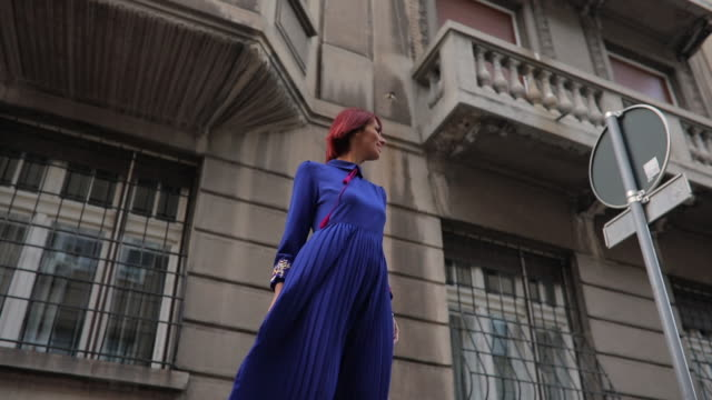 Redhead woman in blue dress One woman, beautiful elegant young redhead lady, standing the city street. dyed red hair stock videos & royalty-free footage