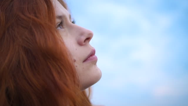 Redhead Young Woman Looking Up To Sunset Sky With Hope Pray Prayer