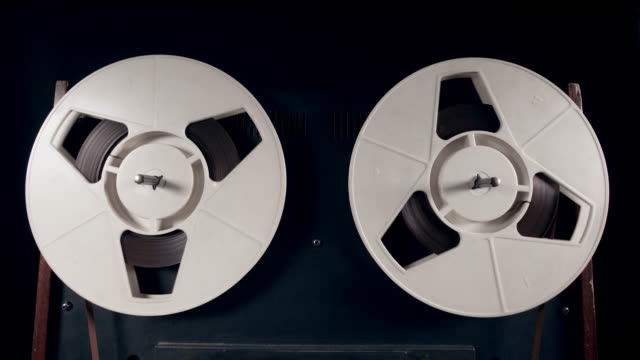 Reels are slowly spinning with tape on them