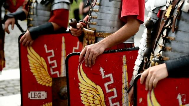 reenactment video detail with roman soldiers uniforms - stile classico romano video stock e b–roll