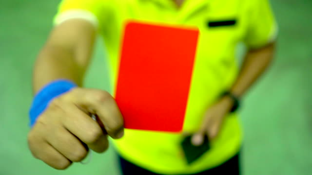 Referee hands showing red card : Slow motion Referee hands showing red card : Slow motion playing card stock videos & royalty-free footage